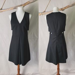 1. State Side Cut Out Black A-line Dress